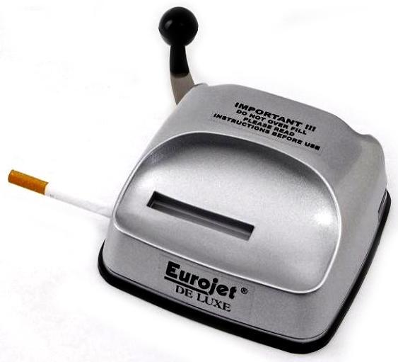 В киоске покупают табак и сигаретную бумагу,  а рядом — автомат, который скручивает сигареты…